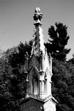 A lonesome grave marker stands in a cemetery collecting dust and patina , black and white Royalty Free Stock Images