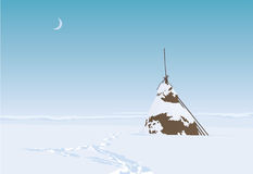 Lonesome haystack on a field in snowy winter Royalty Free Stock Images