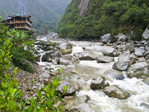 Lonesome house at a wild river. Lonesome house at the end of the little village Aguas Calientes, the starting point for tours to Machupicchu, Peru. Through the Stock Image