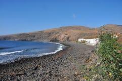 Lonesome remote beach on volcanic canary island Lanzarote Stock Photos