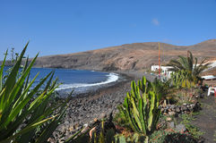 Lonesome remote beach on volcanic canary island Lanzarote Stock Image