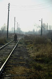 Lonesome Road. An old woman going down the railroad Stock Photos