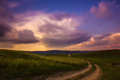 Lonesome Road. With dramatic sky Stock Photos