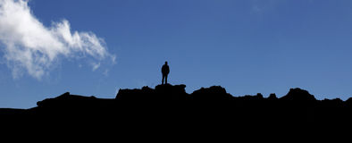 Lonesome silhouette of man on volcanic scenic horizon Stock Photography