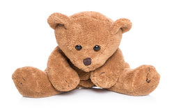 Lonesome teddy bear isolated on white. Royalty Free Stock Images