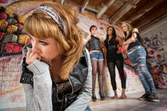 Loney Girl Teased. Lonely female being teased by group of people Stock Photos