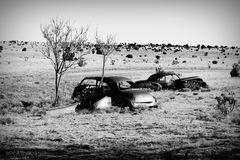 Route 66 - the Road to Nowhere. Long ago wrecked vehicles sit alongside Route 66 in New Mexico; The desert is slowly returning the rusted metal to the soils Royalty Free Stock Photo