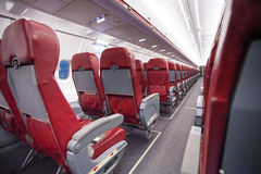 Long aisle with rows of sits in airplane economy Royalty Free Stock Image
