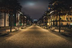 Night alley in Berlin. Long alley in the city at night. Picturesque night street near Reichstag building in Berlin stock photos