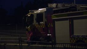 A long ang big fire rescue truck. A full pan to right establishing shot of a fire truck stock video footage