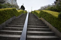 The long ascent of the Lyon Street Steps, 4. Many of San Francisco`s steps have very beautiful mosaics added to the steps which add to the enjoyment of royalty free stock images