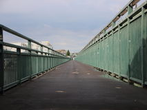 Long Asphalt Footpath with Green Metal Banisters Perspective. Very long Asphalt Footpath with Green Metal Banisters Perspective stock photo