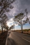 Long asphalt road on the beautiful countryside. Long asphalt road on the beautiful countryside located in Martimlongo, Portugal Royalty Free Stock Images