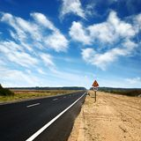 Long asphalt road and blue sky Stock Image