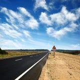 Long asphalt road and blue sky Stock Image