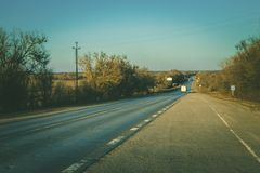 Long asphalt road at sunset. Stock Photography
