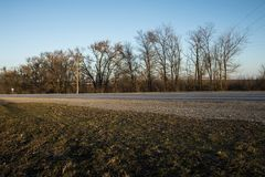 Long asphalt road at sunset. Royalty Free Stock Photography