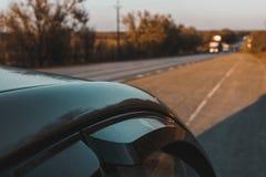 Long asphalt road at sunset. Stock Photo