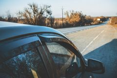 Long asphalt road at sunset. Royalty Free Stock Image