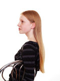 Long auburn hair. Side view of a young model with long straight auburn hair Royalty Free Stock Photo