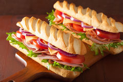 Long baguette sandwich with ham cheese tomato and lettuce Royalty Free Stock Image