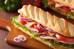Long baguette sandwich with ham cheese tomato and lettuce Stock Photo