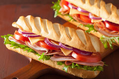 Long baguette sandwich with ham cheese tomato lettuce Royalty Free Stock Images