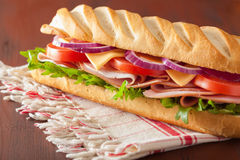 Long baguette sandwich with ham cheese tomato lettuce Stock Photo