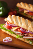 Long baguette sandwich with ham cheese tomato lettuce Stock Image