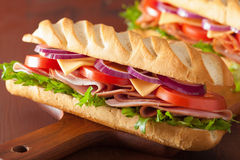 Long baguette sandwich with ham cheese tomato lettuce Stock Images