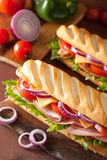 Long baguette sandwich with ham cheese tomato lettuce Royalty Free Stock Photography