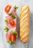 Long baguette sandwich with ham tomato lettuce Royalty Free Stock Images