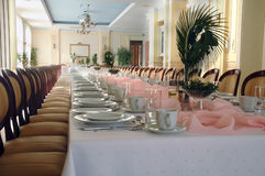 Long banquet table with flower. Long pink banquet table perspective with flower royalty free stock photography