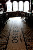 Long bar and stools inside famous restaurant, The Black Rose,Boston,Mass,2014 Royalty Free Stock Image