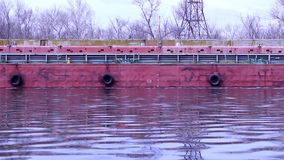 Barge along the concrete wall stock video
