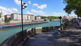 Long barge on Rhone river in Lyon stock footage