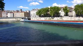 Long barge on Rhone river in Lyon stock video footage