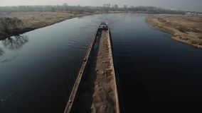Long barge for sand transportation moves on the river. Top view. From above. Outdoor. stock video
