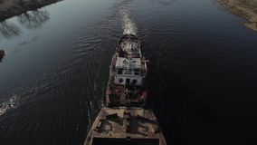 Long barge for sand transportation moves on the river. Top view. From above. Outdoor. stock footage
