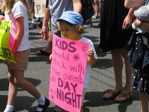 Children march to keep immigrant families together. Long Beach, California USA–June 30, 2018: A small child holds a sign referencing the Trump policy of royalty free stock photography