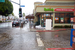 Long Beach flooding. Flooded street in Belmont Shore. Rubio's Fresh Mexican Grill in Long Beach, California, had to put sand bags Royalty Free Stock Images