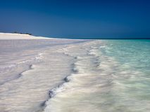 Long beach, gentle waves, turquoise sea royalty free stock photography