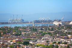 Long Beach harbor and biggest shipping port of US. Aerial view of Long Beach harbor - biggest shipping port of USA with containers, hoists and ships Royalty Free Stock Photos