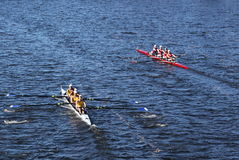Long Beach Junior Crew(L) and  the Windsor School (r) race in the Head of Charles Regatta Royalty Free Stock Photos