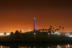 Long Beach lighthouse Purple. Lighthouse in Long Beach California at night with the glow of the pier in the background Stock Photography