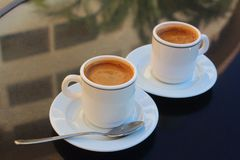 Two cups of coffee. Long Beach Resort&Spa Hotel, Alanya, Turkey. Two cups of coffee Royalty Free Stock Photo