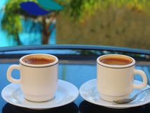 Two cups of coffee. Long Beach Resort&Spa Hotel, Alanya, Turkey. Two cups of coffee Royalty Free Stock Images