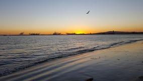 Long Beach At Sunset. Long Beach Shoreline taken from the beach below Bluffs Park Stock Image