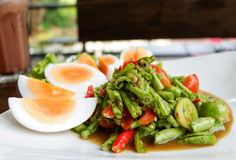 Long bean salad Spicy. And egg thai food Vigna unguiculata subsp stock image