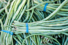 Long Beans. Bunches of long beans at a Chinese vegetable stall at the Clement Street Farmer's Market in San Francisco stock image
